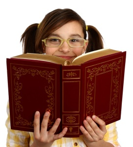 stockvault-a-smart-girl-with-glasses-reading-a-book158955