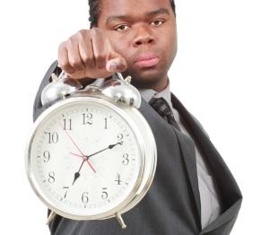 stockvault-man-with-clock127680