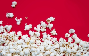 stockvault-popcorn-spilled-on-red-background174861
