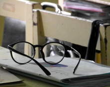 stockvault-glasses-on-a-school-desk174921