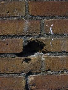 stockvault-cracked-brick-wall98649