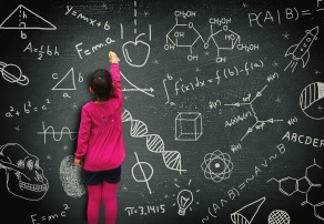 Little girl writing on blackboard - Learning and knowledge conce