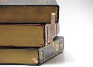 stockvault-close-up-of-antique-books-on-a-white-bac159358