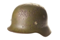 German rusty army helmet on a white background