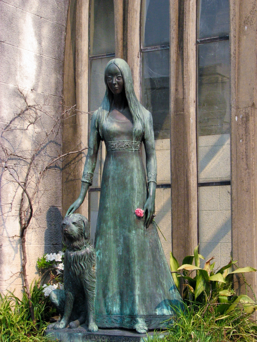 A memorial statue of a woman and her dog in the Recoleta cemetery. Buenos Aires, Argentina.