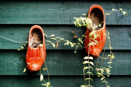 stockvault-clogs-hanging-on-fence132202