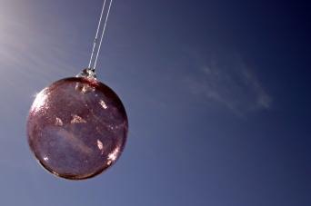 stockvault-glass-ball-against-the-sky99033