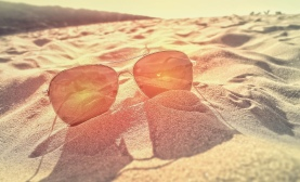 Sunglasses on the Sand at Sunset - Summer and Beach Holidays