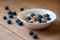 yogurt with superfood granola and blueberries