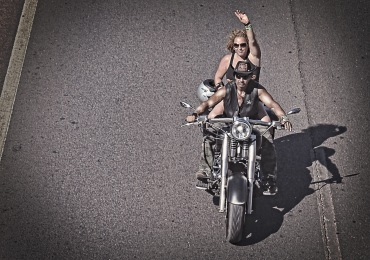 Biker waving on a Harley Davidson - Grunge look