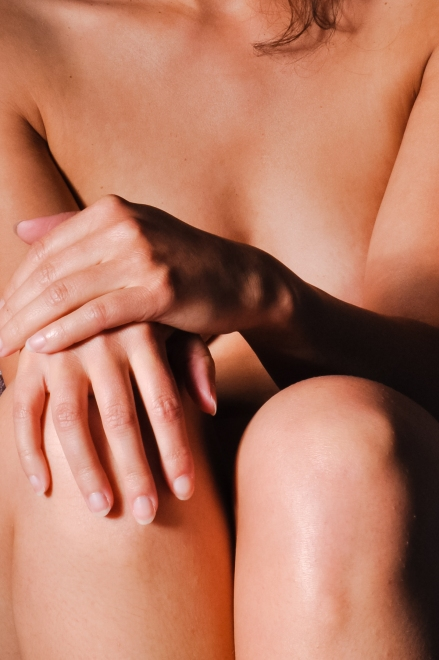 Close up nude woman body and hands
