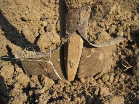 stockvault-a-shovel-in-the-soil146705