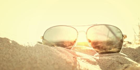 Sunglasses on the Sand at Sunset - Beach Holidays